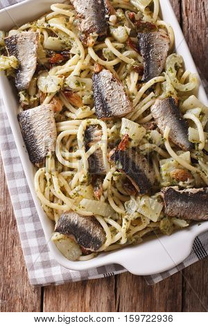 Italian Pasta Bucatini With Sardines, Fennel, Raisins And Pine Nuts Close Up. Vertical Top View
