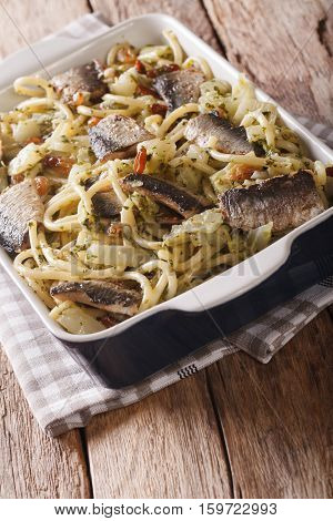 Italian Food: Pasta With Sardines, Fennel, Raisins And Pine Nuts Close Up In Baking Dish. Vertical