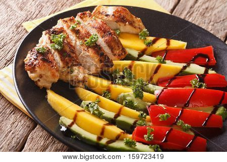 Grilled Chicken Breast With Fresh Mango, Avocado And Peppers With Balsamic Sauce Close-up. Horizonta