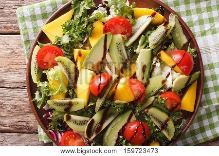 Fruit Vegetable Salad Of Mango, Avocado, Kiwi, Tomato And Lettuce Close-up. Horizontal Top View