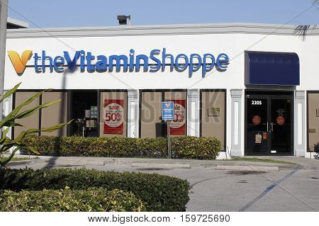 Fort Lauderdale FL USA - April 26 2016: Front of the Vitamin Shoppe retail shop on a sunny day. Facade of the Vitamin Shoppe store with a parking lot in front