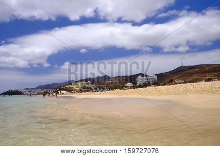Beach Playa de Morro Jable with unknown people. Canary island Fuerteventura Spain - 25.06.2016.