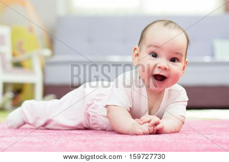 Sweet Baby Girl Is Crawling On Carpet
