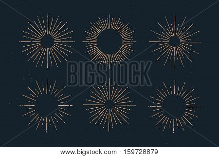 Set of vintage hand drawn sunbursts on dark background. Starburst, sunrays. Design elements.