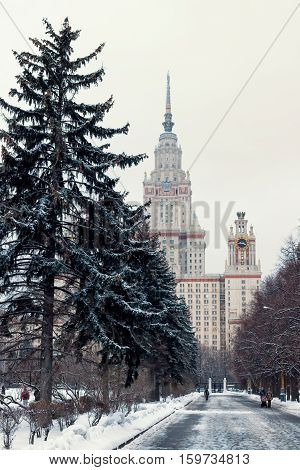 Track in the park leading to the Moscow State University building. Main building of the Lomonosov Moscow State University. MGU. The Sparrow Hills Moscow Russia. Winter.