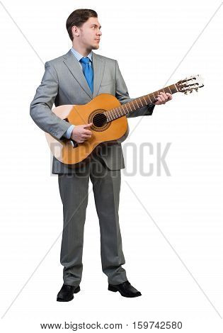 Full length of young businessman playing guitar on white background