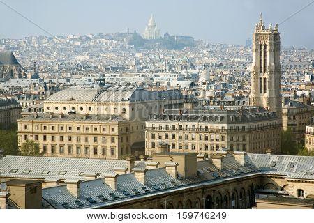 Bird-view of Paris from the Notre-Dame de Paris. Saint-Jacques Tower and basilica Sacre-Coeur