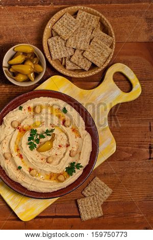 Healthy Homemade Hummus Dip with Olive Oil. Selective focus.