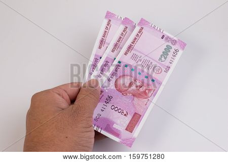 2000 rupee new Indian Currency publish on 9 November 2016. Close up of the new rupee 2000 banknote on man hand. Mahatma Gandhi on Indian 2000 rupee banknote. poster