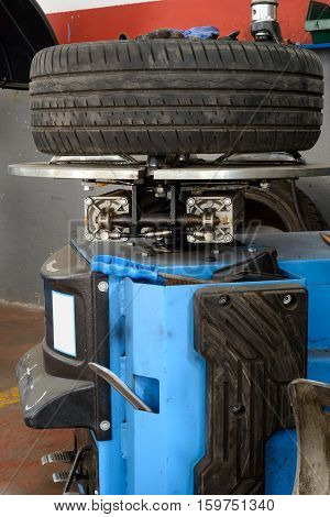 A tire on a fixing machine ready to be fixed