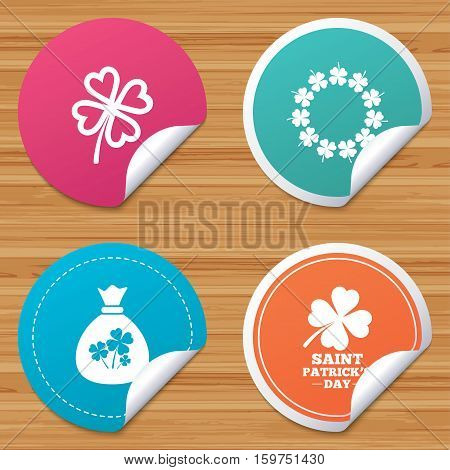 Round stickers or website banners. Saint Patrick day icons. Money bag with clover sign. Wreath of quatrefoil clovers. Symbol of good luck. Circle badges with bended corner. Vector
