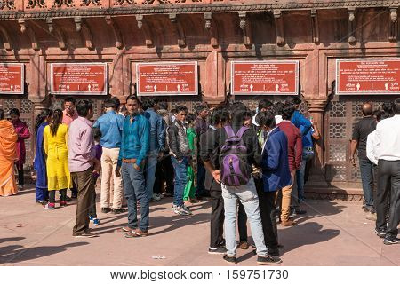 AGRA INDIA - Nov 27 2016: Foreign and local tourist line up at ticket counters on Western Gage of Taj Mahal to buy tickets for visit Taj Mahal Monument of love on 27 November 2016.