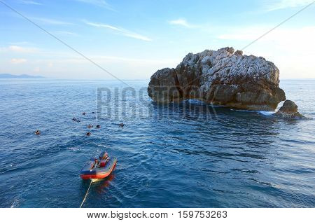 Dinghy boat mooring on ocean with Calm and smooth sea in tropical island. Dinghy boat waiting for scuba divers.