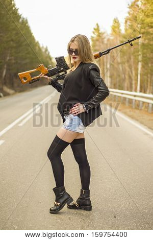 Girl Assassin Waiting For His Victim On The Road.