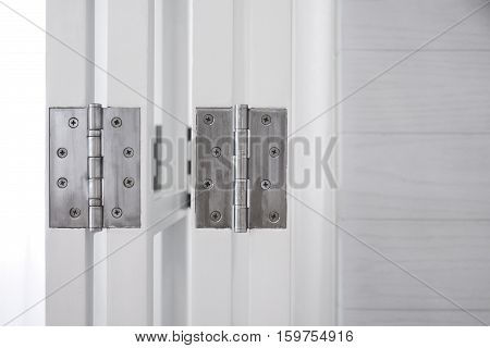 Door hinge on wooden door vintage style