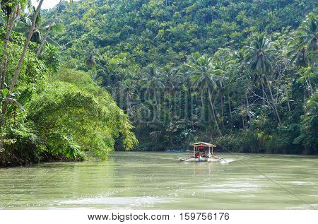 Outrigger boat on a tropical river in South-East Asia