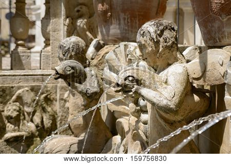 Particular of a fountain angel statue in Tivoli Italy