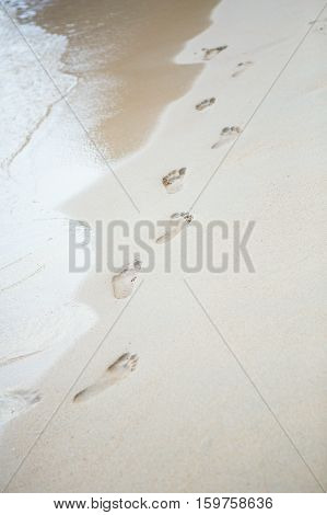 Footsteps On A Perfect White Sand Beach