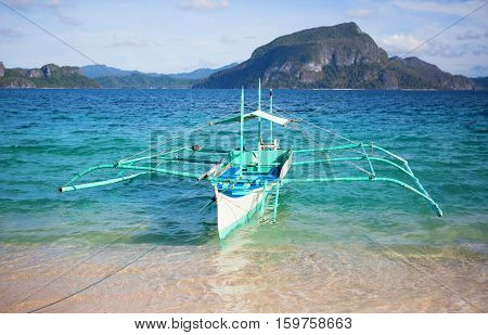 Outrigger Boat Near The Shore On Palawan, Philippines