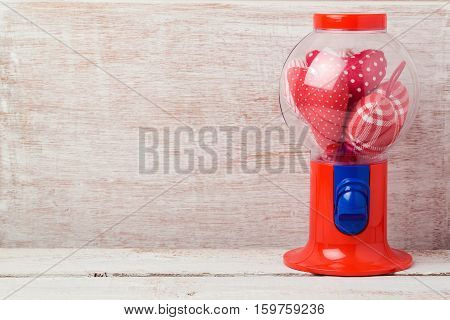 Valentine's day background with gumball machine and heart shape
