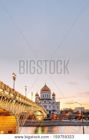 View of the Cathedral of Christ the Savior and the Patriarchal bridge pedestrian. Evening time