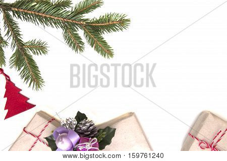 Christmas composition. Green tree twings, Xmas gifts and decorations on white background. Top view, flat lay. Copy space for text. Winter holidays concept