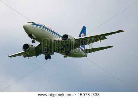 SAINT PETERSBURG, RUSSIA - JULY 03, 2016: Boeing 737-500 (EW-294PA) airlines Belavia in twilight sky