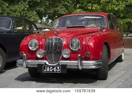 TURKU, FINLAND - JUNE 13, 2015: Red Jaguar Mk-1 - the participant of parade of vintage cars