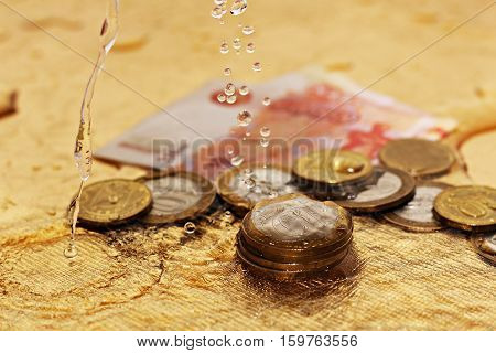 Coins under water, russian golden money, money laundering