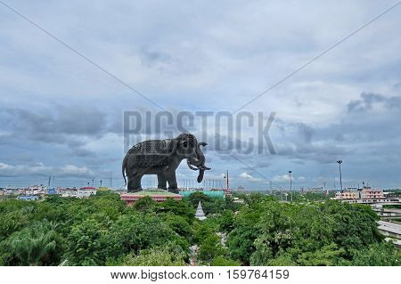 Take a photo the monument of great elephant with 3 heads call Erawan Elephant in Asia and cloudy sky as the car sped through at Samutprakarn Thailand. Selective focus