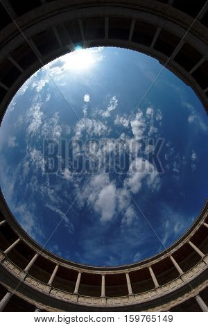 Fisheye view of sky above Palacio de Carlos V in Granada spain