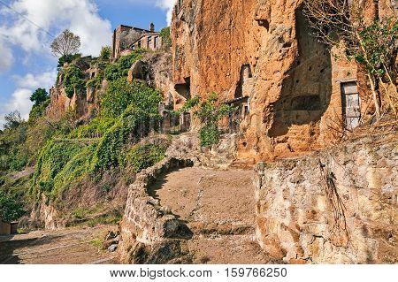 Civita di Bagnoregio, Viterbo, Lazio, Italy: the rock face of the tuff hill where it was built the medieval village