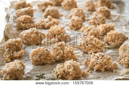 preparation of rice balls or sicilian arancine
