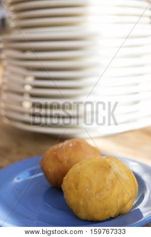 tasty fried appetisers on a white dish dish