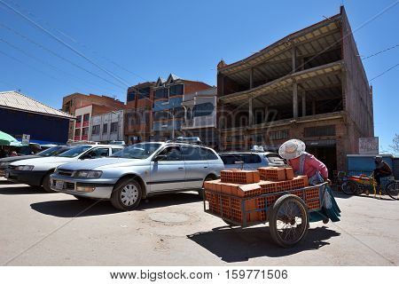 DESAGUADERO BOLIVIA - August 25 2016: Unidentified people on street of Desaguadero Bolivia on August 25 2016. Desaguadero is a town on the Bolivian-Peruvian border.