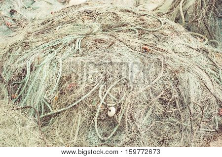 Discolored fishing nets and floats as background