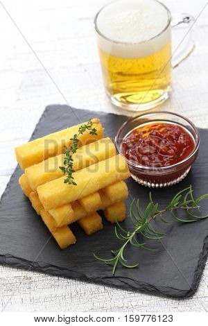 fried polenta with dipping sauce, and beer