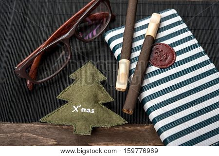 Cigarillos, Cigars, Notepad And Glasses On A Bamboo Napkin