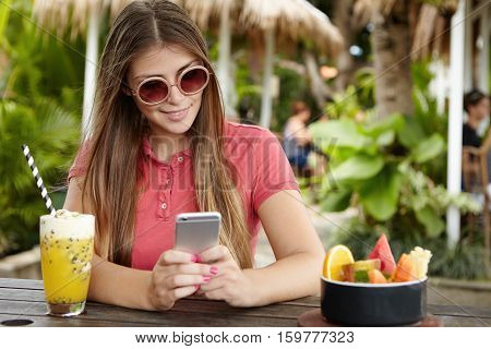 People, Leisure, Technology And Communication. Young Lady With Beautiful Long Hair Holding Smart Pho