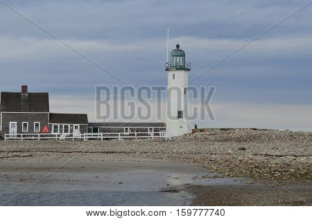 Old Scituate Light and rocky coast in Scituate harbor in Massachusetts.