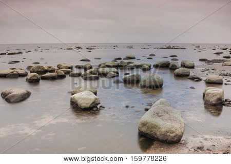 minimalism in nature, the rocks in the water, the Gulf of Finland, Karelian isthmus, Russia