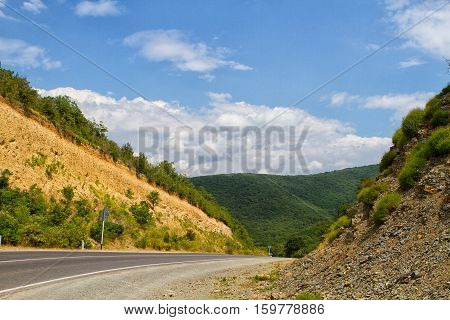 Spring landscape with Russian Caucasus green mountains