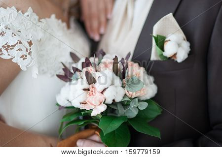 Wedding bouquet of beautiful flowers in the bride's hands
