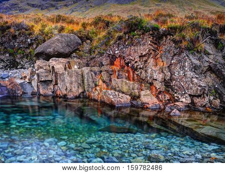 Rusted rocks in Fairy Pools Glen Brittle Isle of Skye Inner Hebrides Highlands Scotland