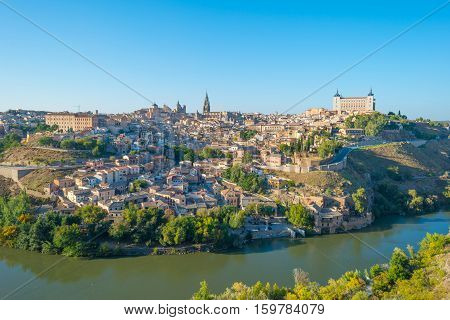 The medieval city of Toledo on a hill in sunlight