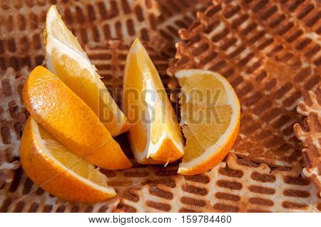 Sliced orange slices on the background of the home wafers