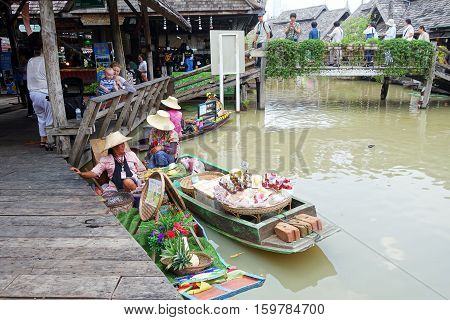 PATTAYA THAILAND - 22 NOV 2016: Travel and shopping in Pattaya Floating Market four regions where have traditional commercial boats and villagers do about traditional foods and souvenirs
