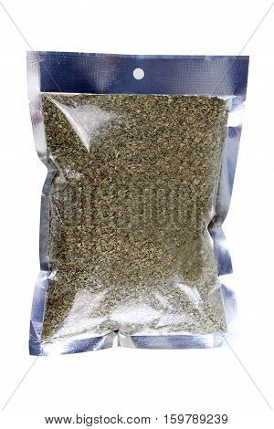 dried oregano (Origanum vulgare) in packaging foil. Isolated on white with clipping paths.