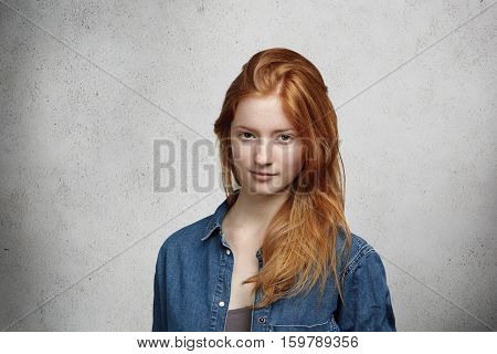 Close Up View Of Beautiful Young Caucasian Woman With Ginger Hair And Freckles Wearing Stylish Cloth