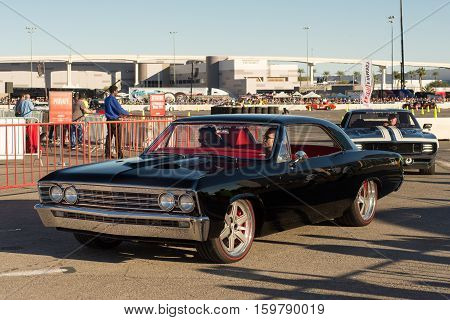 LAS VEGAS NV/USA - NOVEMBER 4 2016: Roadster Shop's 1967 Chevrolet Chevelle followed by the Ringbrothers 1969 Camaro cars at the Specialty Equipment Market Association (SEMA) 50th Anniversary auto trade show parade.